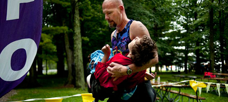 Dad Carries Daughter with Cerebral Palsy in Triathlons