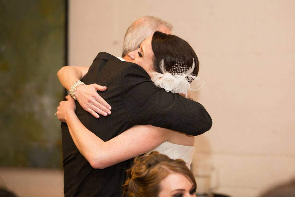 Huggin' it out at our wedding